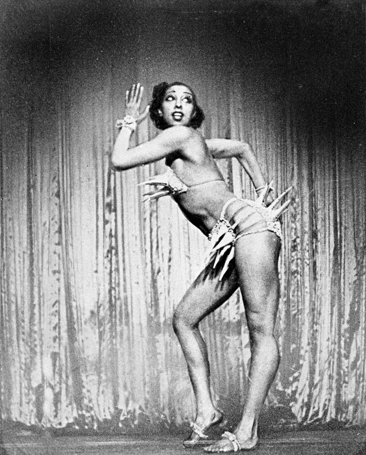 """Performer Josephine Baker strikes a pose during her Ziegfeld Follies performance of  """"The Conga"""" on the Winter Garden Theater stage in New York, Feb. 11, 1936.  Her appearance in Broadway's """"Going to Town"""" is the first since she left the United States ten years ago. AP Photo"""